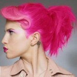 Woman with bright pink hair