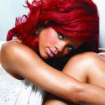 Rihanna with bright red hair