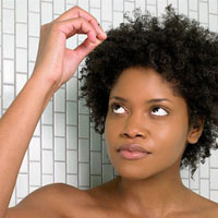 Woman finding a gray hair