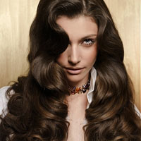 Woman with long, naturally curly brown dark hair color
