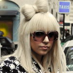 Lady Gaga with blonde hair and a bo