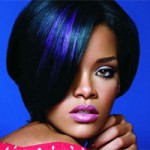 Rhianna with blue highlights in dark hair