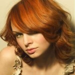 Woman with red and auburn hair