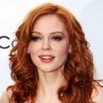 Rose McGowan with curly auburn hair