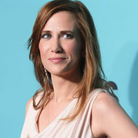Kristen Wiig with auburn to brown hair