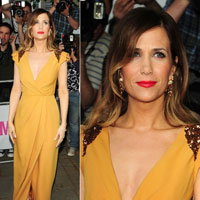 Kristen Wiig on the catwalk with brown hair
