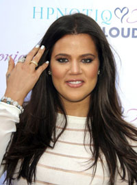 Khloe Kardashian with her new dark hair color